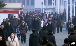 In this image made from video, pedestrians brave the cold as the make their way through an open square, Jan. 30, 2020, in Pyongyang, North Korea.