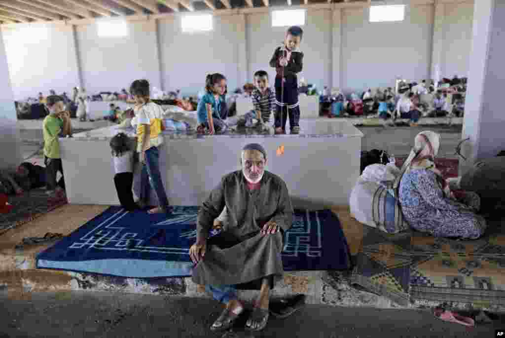 An elderly Syrian man, who fled his home due to fighting between the Syrian army and the rebels, takes refuge at the Bab Al-Salameh border crossing, in hopes of entering one of the refugee camps in Turkey, near the Syrian town of Azaz, Aug. 23, 2012.