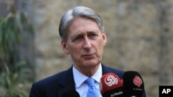 FILE - Philip Hammond, then the British foreign secretary, speaks at a press conference at the British embassy in Baghdad, Iraq, March 16, 2016.