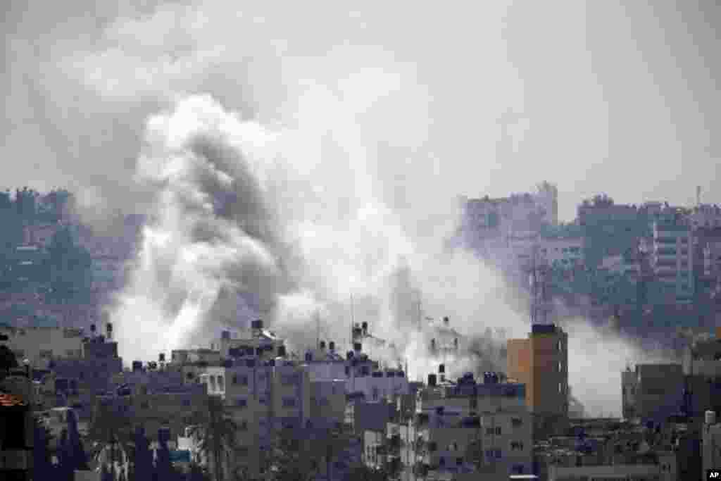 Smoke from an Israeli strike rises over Gaza City, July 23, 2014.