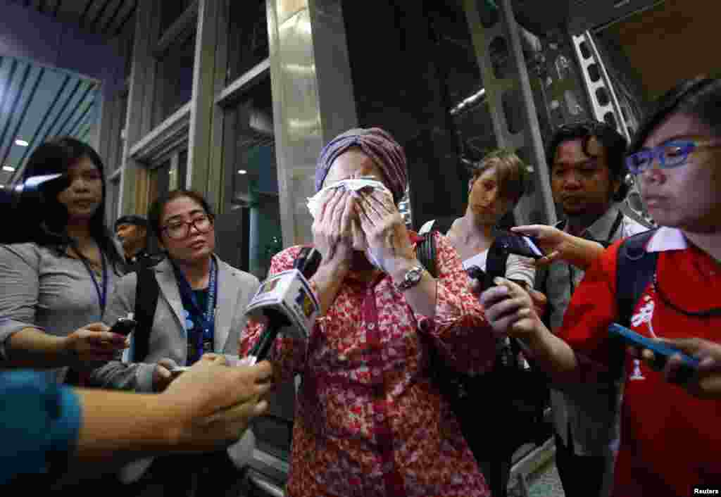 A woman, who said her name was Noraini and that she believed a relative of hers was on Malaysia Airlines flight MH-17, cries as she waits for more information about the crashed plane, at Kuala Lumpur International Airport in Sepang. The Malaysian Boeing 777 airliner was brought down over eastern Ukraine, killing all 295 people aboard.