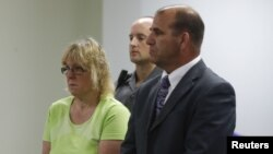 Joyce Mitchell, accused of smuggling contraband into the prison from which two convicts escaped last week, stands with her attorney, Keith Bruno, as she is arraigned in City Court in Plattsburgh, New York, June 12, 2015.