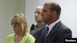 FILE - Joyce Mitchell, accused of smuggling contraband into the prison from which two convicts escaped, is arraigned in City Court in Plattsburgh, New York, June 12, 2015.