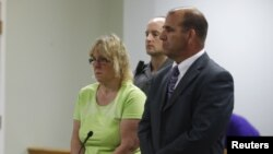 FILE - Joyce Mitchell, accused of smuggling contraband into the prison from which two convicts escaped last week, is arraigned in City Court in Plattsburgh, New York, June 12, 2015.