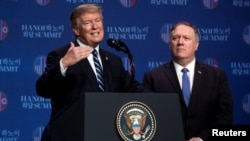 FILE - U.S. President Donald Trump accompanied by U.S. Secretary of State Mike Pompeo speaks at a news conference, following talks with North Korean leader Kim Jong Un in Hanoi, Vietnam, Feb. 28, 2019.
