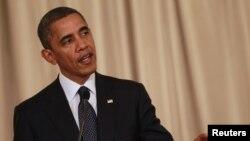 Presiden Barack Obama memberikan keterangan kepada media dalam kunjungannya di Bangkok hari Minggu (18/11).
