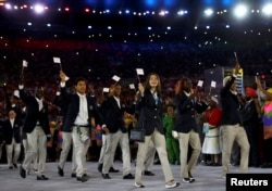 The refugee Olympic team arrives at the Opening Ceremony of the Rio Olympics.