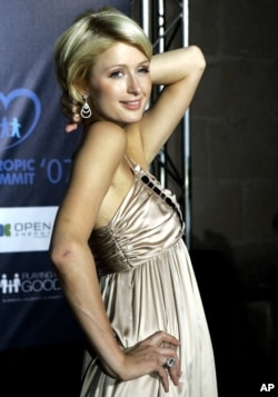 """FILE - Paris Hilton is pictured Sept. 1 2007, in Palma, in the Mediterranean island of Mallorca, Spain. Hilton sued Hallmark Cards Inc. in U.S. District Court on Sept 7, 2007, seeking an injunction and unspecified damages to be determined at trial over the use of her picture and catchphrase """"That's Hot"""" on a greeting card."""