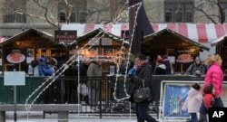 "FILE - An 8½-foot-tall letter ""A,"" which stands for atheist or agnostic, erected by the Wisconsin-based Freedom From Religion Foundation, is on display at the annual Christmas market in Chicago's Daley Plaza, Dec. 10, 2013."
