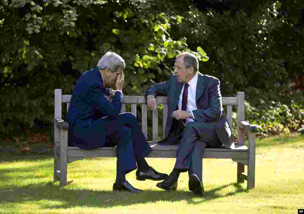 U.S. Secretary of State John Kerry, left, and Russian Foreign Minister Sergey Lavrov sit together on the grounds of the U.s. Chief of Mission Residence in Paris, France. The top diplomats are hoping to find a way to begin reversing a yearlong spike in tensions stemming from Ukraine's revolution and civil war.