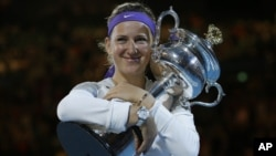 Victoria Azarenka of Belarus hugs her trophy after winning the women's final against China's Li Na at the Australian Open tennis championship in Melbourne, Australia, January 26, 2013.