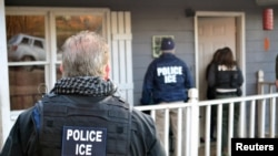 U.S. Immigration and Customs Enforcement officers conduct a targeted enforcement operation in Atlanta, Georgia, Feb. 9, 2017.