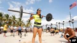 CrossFit is not just for the boys. CrossFit trainer Daniella Estrella competes in Miami Beach, Florida for a grand prize of $21 thousand dollars. (Oct. 2013)