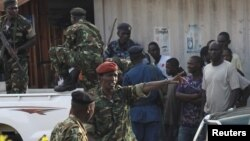 FILE - Burundi's former Defense Minister Cyrille Ndayirukiye, center, points during an attempted coup in the capital Bujumbura, May 13, 2015.