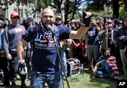 FILE - Joey Gibson speaks during a rally in support of free speech April 27, 2017, in Berkeley, Calif.