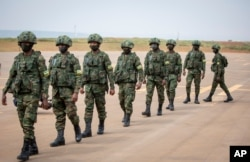 Rwandan armed forces prepare to board a flight at the airport in Kigali to Mozambique, July 10, 2021,to help battle an Islamic extremist insurgency.