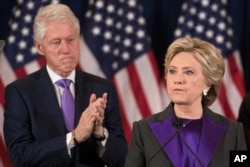 FILE - Former President Bill Clinton applauds as his wife, Democratic presidential candidate Hillary Clinton speaks in New York where she conceded her defeat to Republican Donald Trump after the hard-fought presidential election, Nov. 9, 2016.