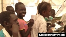 FILE - Displaced South Sudanese children attend class inside a tent set up by UNICEF in Mingkaman, in Lakes State.