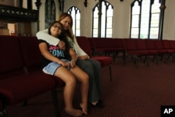 Nury Chavarria, 43, poses with her 9-year-old daughter, Hayley inside Iglesia De Dios Pentecostal church in New Haven, Connecticut, on July 24, 2017. Chavarria has sought sanctuary from deportation because she needs to be with her four children.