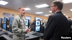 U.S. Defense Secretary Ashton Carter, right, is briefed on the capabilities of the National Guard Cyber Unit at Joint base Lewis-McChord, Washington, March 4, 2016. Carter said the Guard will play an increasingly important role in assessing U.S. vulnerabi