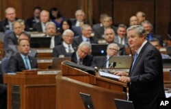 North Dakota Gov. Jack Dalrymple speaks to state's legislature on August 2.
