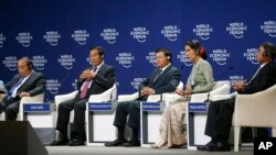 Leaders around the Mekong region talk about their vision in the World Economic Forum on ASEAN at the National Convention Center Wednesday, Sept. 12, 2018, in Hanoi, Vietnam. From left, Prime Minister Nguyen Xuan Phuc of Vietnam, Prime Minister Hun Sen of Cambodia, Prime Minister Thongloun Sisoulith of Laos, Aung San Suu Kyi, state counselor of Myanmar, and Deputy Prime Minister Prajin Juntong of Thailand. The World Economic Forum has attracted hundreds of participants for the three-day forum with the theme: ASEAN 4.0: Entrepreneurship and the Fourth Industrial Revolution. (AP Photo/Bullit Marquez)