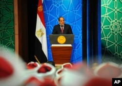 FILE - Egyptian President Abdel-Fattah el-Sissi speaks to Azhar clerics and top government officials in Cairo, Egypt, Dec. 8, 2016.