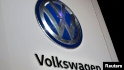 The Volkswagen logo is seen at the company's display during the North American International Auto Show in Detroit, Jan. 10, 2017.