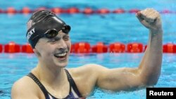 United States' Katie Ledecky celebrates winning the gold medal in the women's 200-meter freestyle at the 2016 Summer Olympics in Rio de Janeiro, Aug. 9, 2016.
