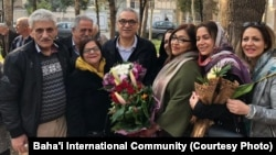 Afif Naeimi, a former leader of Iran's Baha'i community, is greeted by his wife and other loved ones following his Dec. 20, 2018, release from a decade of detention at Tehran's Evin prison.