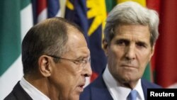 Russian Foreign Minister Sergei Lavrov (L) and U.S. Secretary of State John Kerry