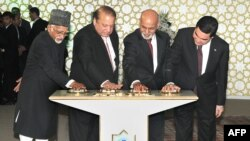 In this photograph released by the Press Information Bureau (PIB) on December 13, 2015, Indian Vice President, Hamid Ansari (L), along with President of Turkmenistan, Gurbanguly Berdimohamedov (R), President of Afghanistan, Ashraf Ghani (2R) and Prime Minister of Pakistan, Nawaz Sharif press the button to begin the welding process of the TAPI Gas Pipeline in Mary, capital of south eastern Mary province.