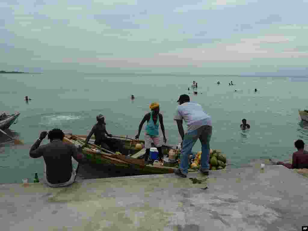 Vendor arrives at harbor near Leogane, Haiti