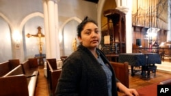 FILE - Amanda Morales seeks refuge in the sanctuary of the Holyrood Episcopal Church, northern Manhattan, Oct. 26, 2017.