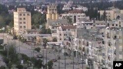 政府軍被指控炮轟霍姆斯。