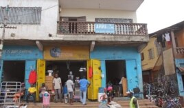 FILE - The Arwa clinic, center, that was closed after the clinic Doctor got infected by the Ebola virus in the capital city of Freetown, Sierra Leone, July 15, 2014..