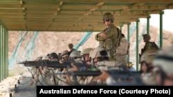 Task Group Taji Australian Army trainer Corporal Benjamin Wallis instructs regular Iraqi Army soldiers during a live-fire range shoot at the Taji Military Complex in Iraq.