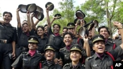 Women's rights activists and opposition party leaders on Monday, June 19, 2006 demanded a top army general be fired for his reported remarks that female officers have no place in India's army. (AP Photo/M. Lakshman, File)