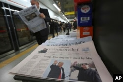 A newspaper with headline telling of a planned summit meeting between North Korean leader Kim Jong Un and U.S. President Donald Trump is displayed at a subway station in Seoul, South Korea, March 10, 2018.