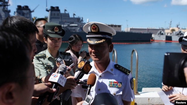 Zhao Xiaogang, drill director of the Chinese fleet participating in the RIMPAC multinational military exercise, joins in a news conference at Joint Base Pearl Harbor Hickam in Honolulu, Hawaii June 30, 2014.