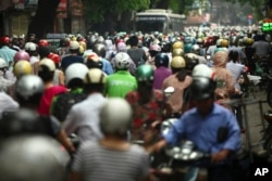 n this photo taken Monday, May 21, 2012, motorcyclists drive in rush hour on La Thanh street which is one of the worst traffic jam roads, in Hanoi, Vietnam.