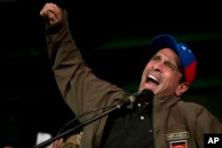 Venezuelan opposition leader Henrique Capriles speaks to supporters during a meeting in Caracas, Venezuela, April, 7, 2017.