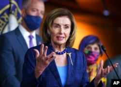 FILE - Speaker of the House Nancy Pelosi, D-Calif., speaks during a news conference at the Capitol, July 30, 2021.