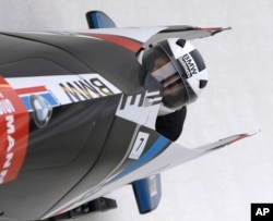 FILE - United States' Elana Meyers with brakeman Lauryn Williams compete in a bobsled designed by BMW Designworks USA in the women's bobsled World Cup event in Lake Placid, N.Y., Dec. 14, 2013.