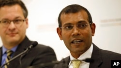 FILE - Former Maldives President Mohamed Nasheed speaks to reporters in London, Jan. 25, 2016. His party said his country's decision to leave the Commonwealth, made without consulting parliament, would damage the Maldives' standing in the international community.