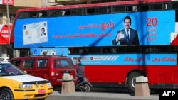 A bus displays a poster advising people to check about their voting information ahead of Iraq's parliamentary elections, on Jan.16, 2018, in the capital Baghdad.