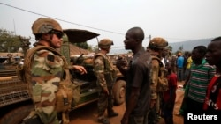 Angry young men complain to French soldiers in patrol in the pro-Christian area of Bangui February 15, 2014