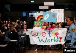 Children participate during climate march before the opening session of the COP23 U.N. Climate Change Conference 2017, hosted by Fiji but held in Bonn, in World Conference Center, Bonn, Germany, Nov. 6, 2017.