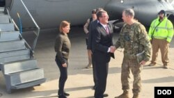 U.S. Defense Secretary Ash Carter greets Army Lt. Gen. Sean MacFarland after arriving in Baghdad, Dec. 16, 2015. Carter is on a weeklong trip to the Middle East.