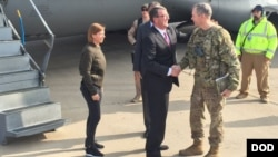 U.S. Defense Secretary Ash Carter greets Army Lieutenant General Sean MacFarland after arriving in Baghdad, December 16, 2015.